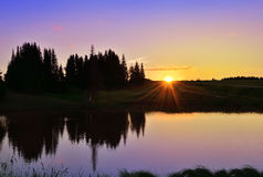 Beautiful sunset in forest lake Royalty Free Stock Photography