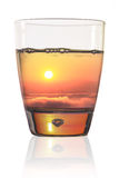 Beautiful sunset in a glass of water Stock Image