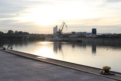Beautiful sunset in the harbor with a crane Royalty Free Stock Photos