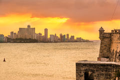 Beautiful sunset in Havana. With El Morro castle on the foreground Royalty Free Stock Images