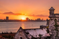 Beautiful sunset in Havana with the sun setting over the seaside buildings Royalty Free Stock Photos