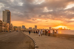 Beautiful sunset in Havana. With a view of cubans and tourists along the Malecon avenue Royalty Free Stock Photography