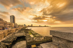 Beautiful sunset in Havana. With a view of cubans and tourists along the Malecon avenue Stock Photography