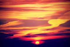 Beautiful sunset with intense and dramatic colors of clouds Stock Photography