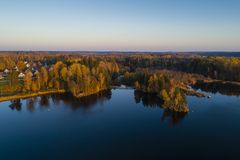 Beautiful sunset in Katrineholm, Sweden, Scandinavia. Lovely nature and landscape on autumn evening. Nice outdoors photo shot with drone in sky from above stock photos