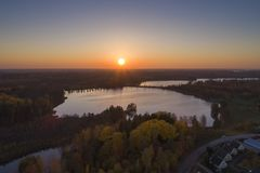 Beautiful sunset in Katrineholm, Sweden, Scandinavia. Lovely nature and landscape on autumn evening. Nice outdoors photo shot with drone in sky from above royalty free stock photo