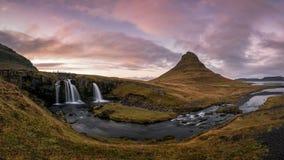 Panorama of Kirkjufellsfoss waterfall and Kirkjufell Mountain in West Iceland royalty free stock photo
