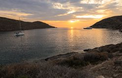 Beautiful sunset in Kolona double bay Kythnos island, Cyclades, Greece. Travel destinations September 2018. Horizontal royalty free stock photos