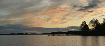 Beautiful sunset on the lake. Beautiful sunset on Engozero lake, Republic of Karelia, northwest of Russia stock photos