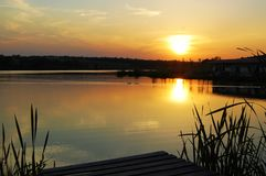 Bautiful sunset at the lake. Beautiful sunset at the lake with calm water and ducks in it royalty free stock image