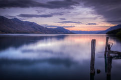 Beautiful sunset at Lake Wakatipu. New Zealand. View of the lake from the pier Stock Photo