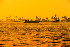Beautiful sunset landscape with houseboats at backwaters Kerala Royalty Free Stock Photography