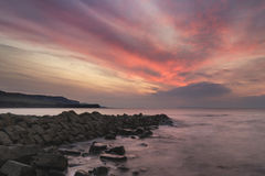 Beautiful sunset landscape image of rocky coastline in Kimmeridg Royalty Free Stock Photo