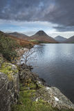 Beautiful sunset landscape image of Wast Water and mountains in Stock Image