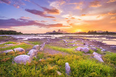 Beautiful sunset landscape with mountain and rock Stock Photography