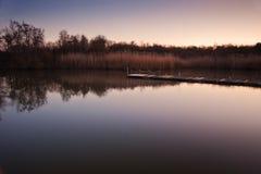 Beautiful sunset landscape over lake Stock Photos