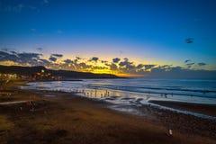 Beautiful sunset on the Las Canteras beach along the city of Las Palmas de Gran Canaria, Spain Royalty Free Stock Photo