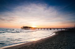 Beautiful sunset in lido di camaiore, tuscany. With a modern pier stock photo