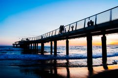 Beautiful sunset in lido di camaiore, tuscany. With a modern pier royalty free stock photo