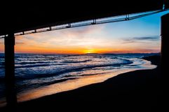 Beautiful sunset in lido di camaiore, tuscany. With a modern pier royalty free stock photos