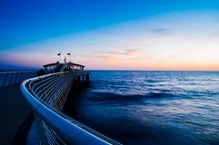 Beautiful sunset in lido di camaiore, tuscany. With a modern pier stock images