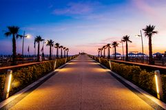 Beautiful sunset in lido di camaiore, tuscany. With a modern pier stock image