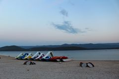 Evening landscape on the beach with boats stock images