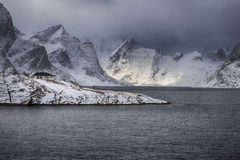 Beautiful sunset at Lofoten Islands Against Snowy Mountains in N Stock Photography