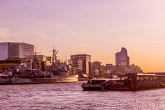 Beautiful sunset in London on the river Thames with buildings and boats. United Kingdom stock photos