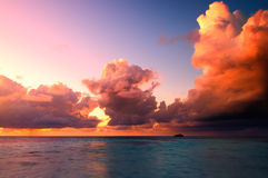 Beautiful Sunset in Maldives. Beautiful sunset over the sea on a cloudy day in Maldives royalty free stock image