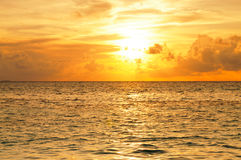 Beautiful Sunset in Maldives. Beautiful sunset over the sea on a cloudy day in Maldives stock image