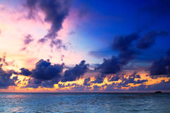 Beautiful Sunset in Maldives. Beautiful sunset over the sea on a cloudy day in Maldives stock photos