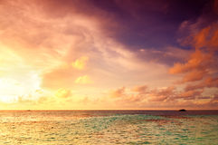 Beautiful Sunset in Maldives. Beautiful sunset over the sea on a cloudy day in Maldives stock photo