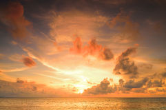 Beautiful Sunset in Maldives. Beautiful sunset over the sea on a cloudy day in Maldives stock photography