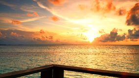 Beautiful Sunset in Maldives. Beautiful sunset over the sea on a cloudy day in Maldives royalty free stock photo