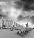 Beautiful sunset on Marina Beach, Dubai with beach chairs and sk Royalty Free Stock Photo