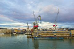 Beautiful sunset and modern seaport with cargo cranes and ships, Helsinki, Finland. royalty free stock photo