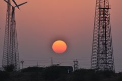 Beautiful Sunset with modern windmill in thar desert jaisalmer Rajasthan India. Sunset with modern windmill in thar desert jaisalmer Rajasthan India Stock Photography