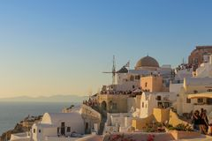 Beautiful sunset at the most famous place of Oia, Santorini. Greece. stock photo