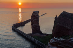Beautiful sunset at most western point of German island Helgoland. Near a cliff named lange Anna royalty free stock photography