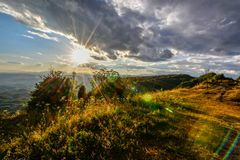 Sunset on the mountain with stormy clouds stock photography