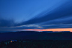 Beautiful sunset in the mountains with illuminated mountain hotel Royalty Free Stock Photography