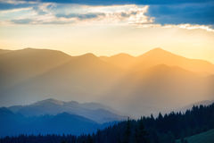 Beautiful sunset in the mountains Stock Images