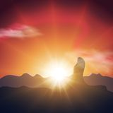 Beautiful sunset in the mountains. Orange sky, long and bright rays ofsun Stock Photography