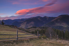 Beautiful sunset in the mountains on a slope Stock Photography