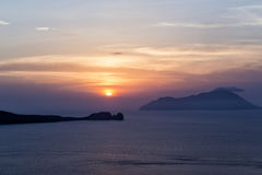 Beautiful sunset near the beach Ampeli, Folegandros. In the back Royalty Free Stock Image