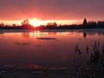 Colorful sunset near river Atmata, Lithuania Stock Photos