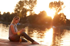 Beautiful sunset near water. Woman enjoy in beautiful sunset near water Royalty Free Stock Photo