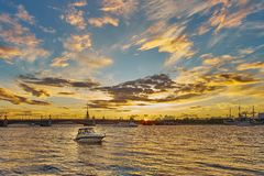 Beautiful sunset on Neva river with Troitsky bridge and Peter and Paul fortress on the background. Saint Petersburg. Russia. Stock Photo
