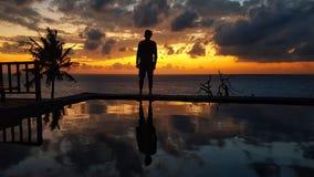 Beautiful Sunset at the ocean beach with man stock photos